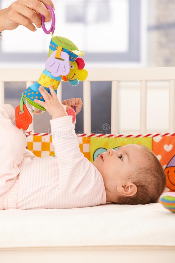Baby girl playing with toy stock photos