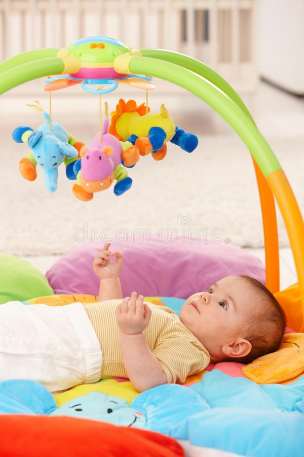 Baby girl on playmat stock photography