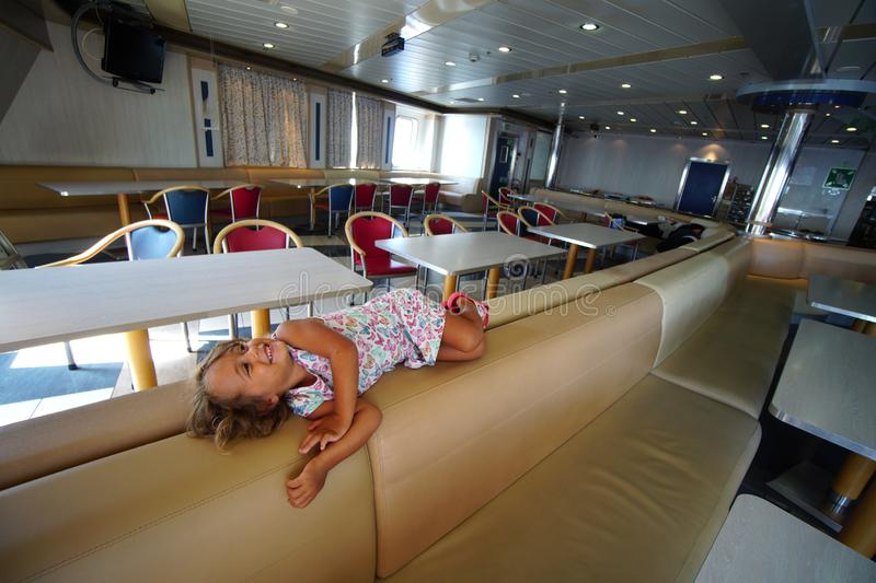 baby girl plays happily on the ferry that takes her on vacation in Greece royalty free stock photos