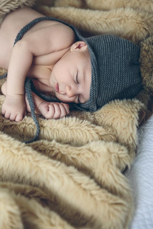 Baby girl with pompom hat sleeping stock images