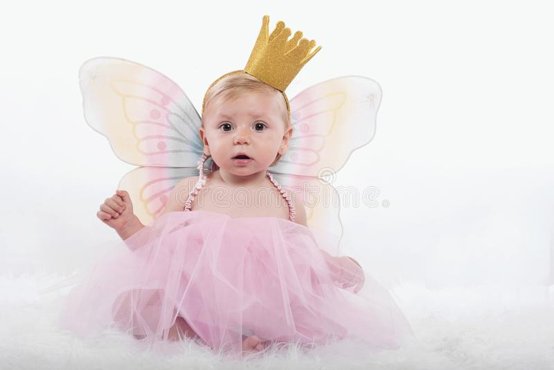 Baby girl in princess costume stock image