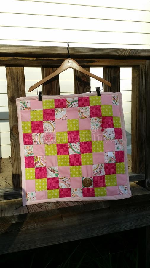 Baby girl quilt royalty free stock photography