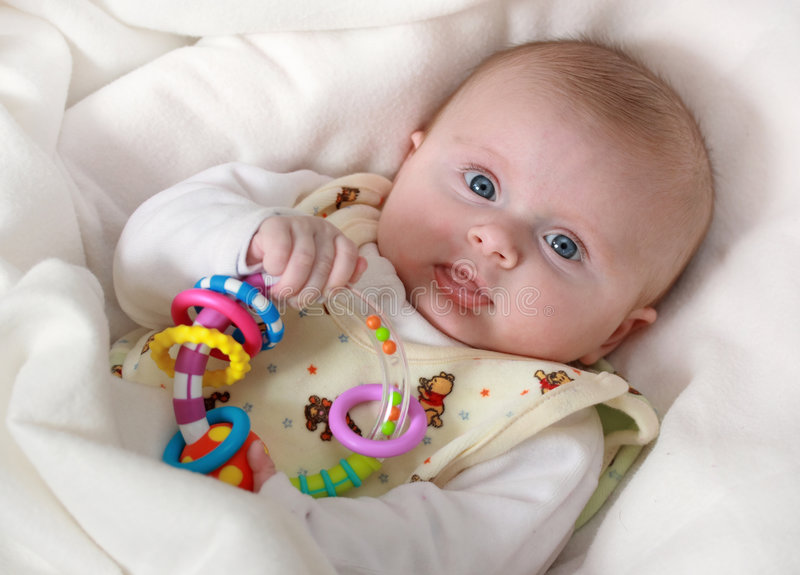 Download Baby Girl With Rattle Stock Images - Image: 4352694
