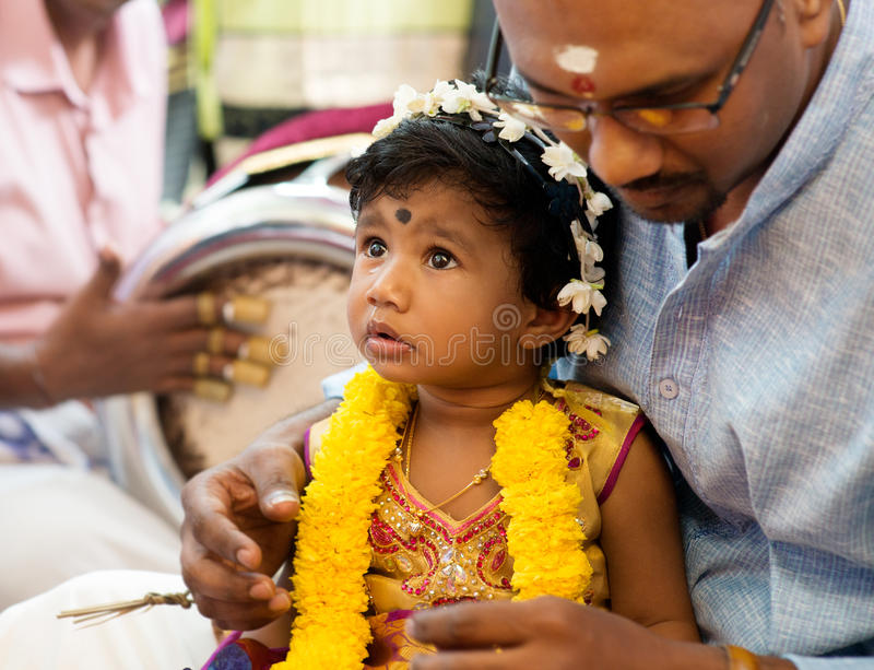 Baby girl received prayers from the karnvedh events. stock photo