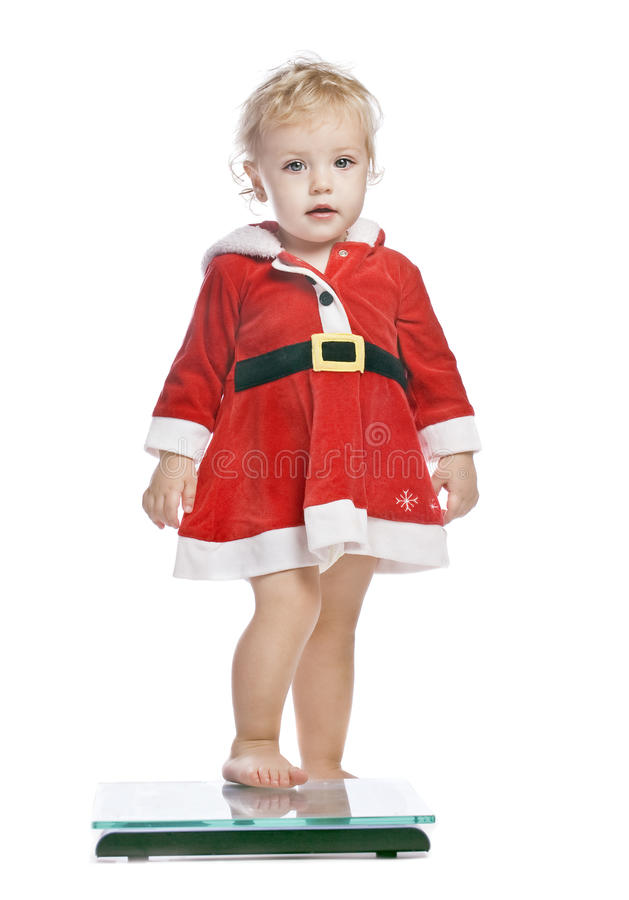 Baby girl in a red christmas fancy dress stock photo
