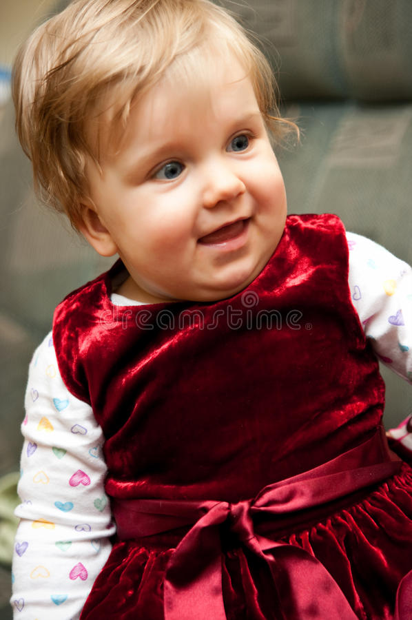 Baby girl in red dress stock images