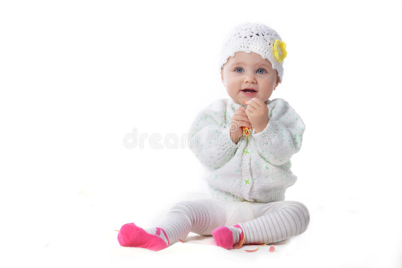 Baby girl with red flower royalty free stock photo