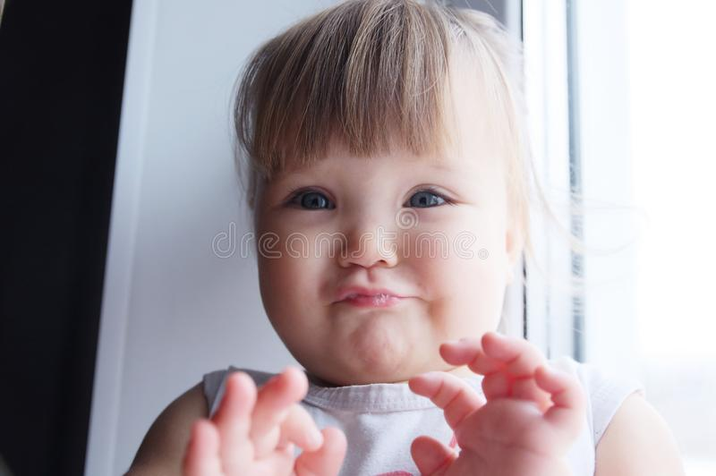 Baby girl refusing, stop hands. toddler say no. little child abandon go to parent stock photo