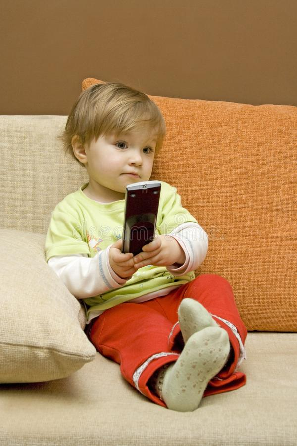 Download Baby Girl With Remote Control Stock Image - Image of life, interior: 8191213