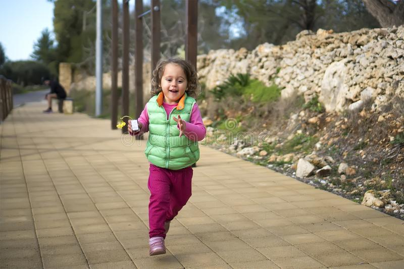 Baby girl is running royalty free stock photo