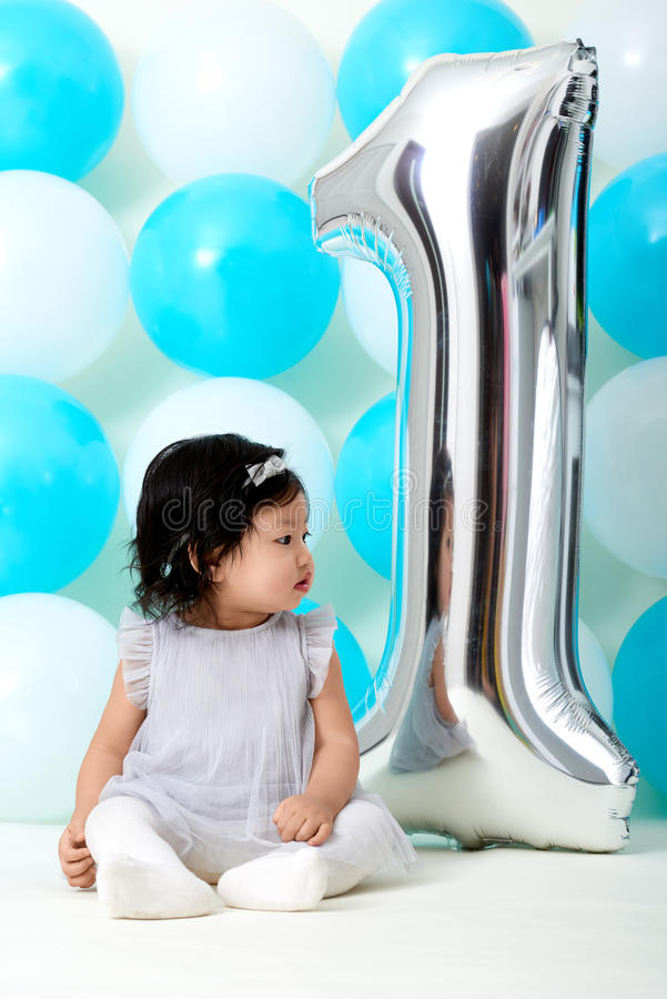 Baby girl`s first birthday stock photography