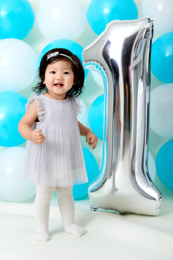 Baby girl`s first birthday royalty free stock photos
