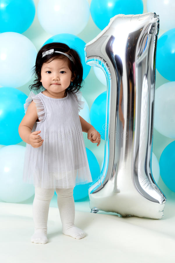 Baby girl`s first birthday royalty free stock images