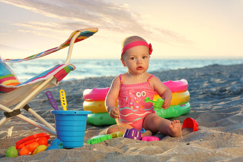 Beach Toys For Girls : Baby girl on the sand beach with toys stock photo image