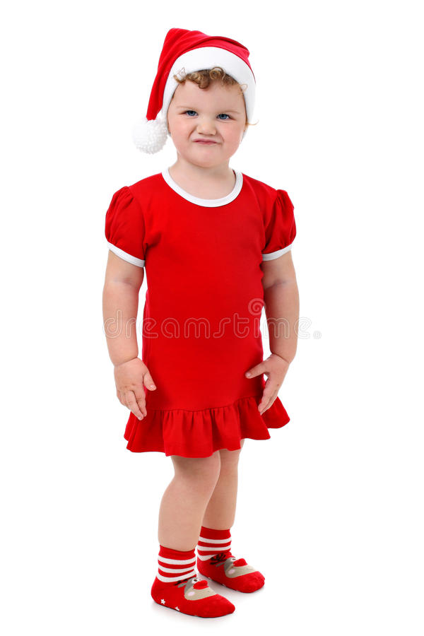 Baby girl in Santa's hat and red dress isolated royalty free stock image