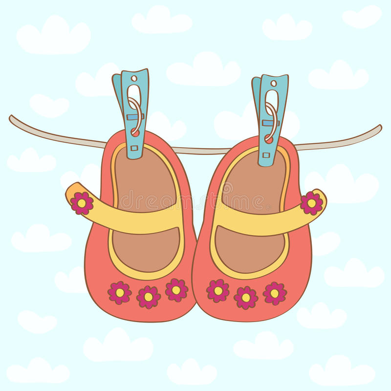 Baby girl shoes. Orange baby girl shoes with pink flowers dried on a rope outside stock illustration