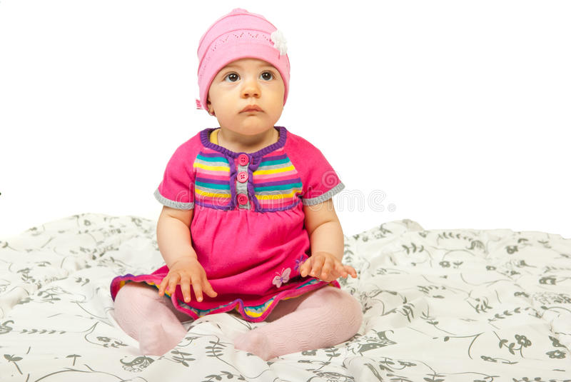 Download Baby girl sitting in bed stock photo. Image of serious - 24237722
