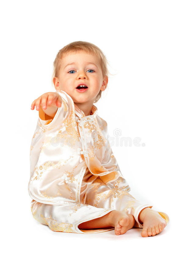 Baby girl sitting and pointing. At something stock photos