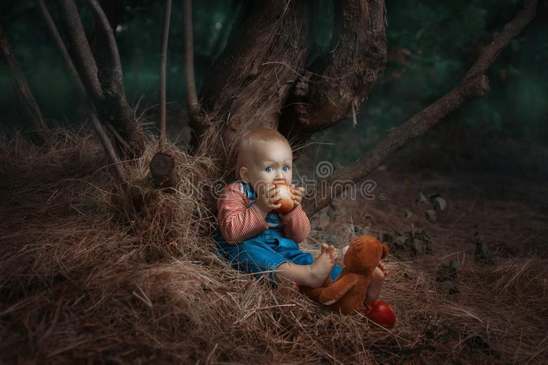 Baby girl eating an apple. stock images