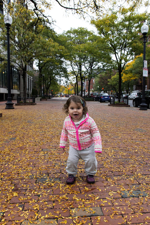 Baby Girl Smiling at Autumn Foliage. In Back Bay, Boston, MA stock photography
