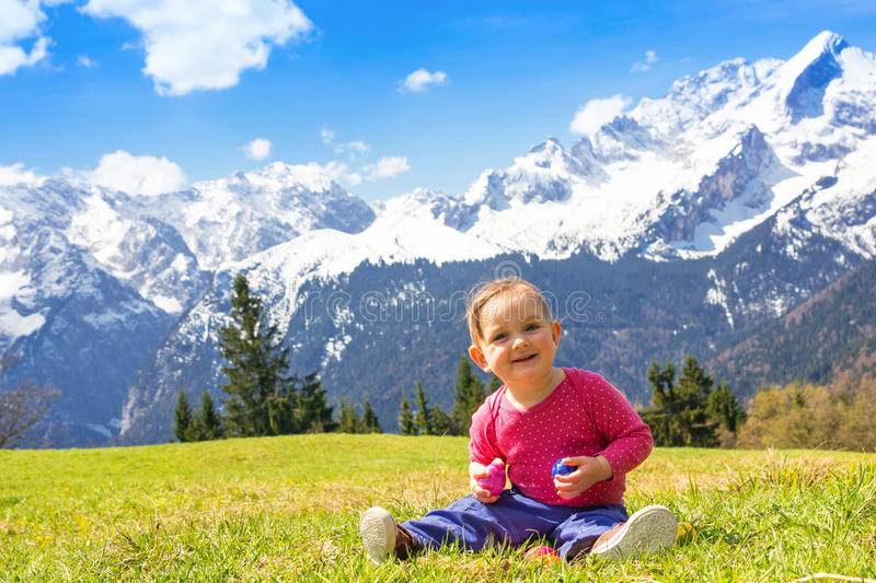 Baby girl in spring mountain royalty free stock images