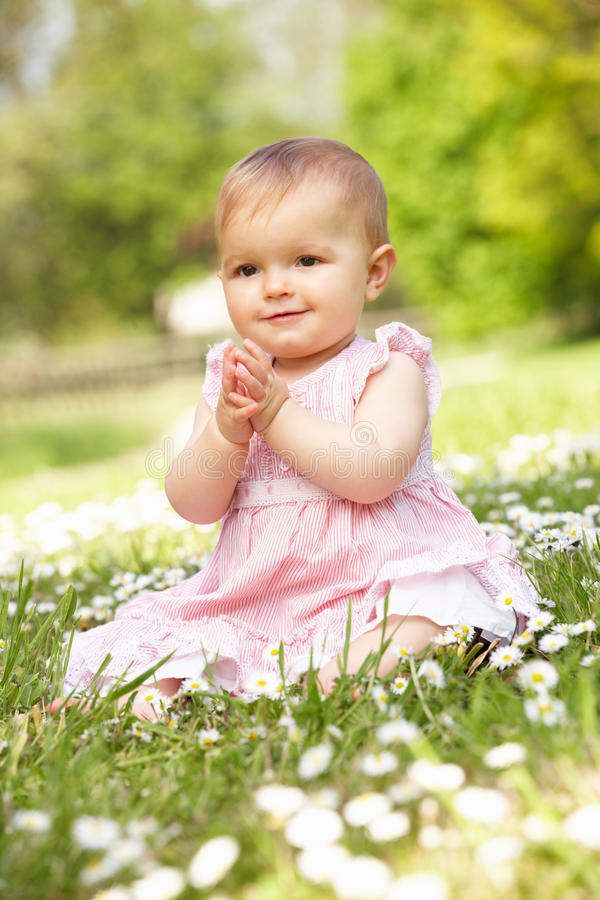Download Baby Girl In Summer Dress Sitting In Field Stock Image - Image: 26103363