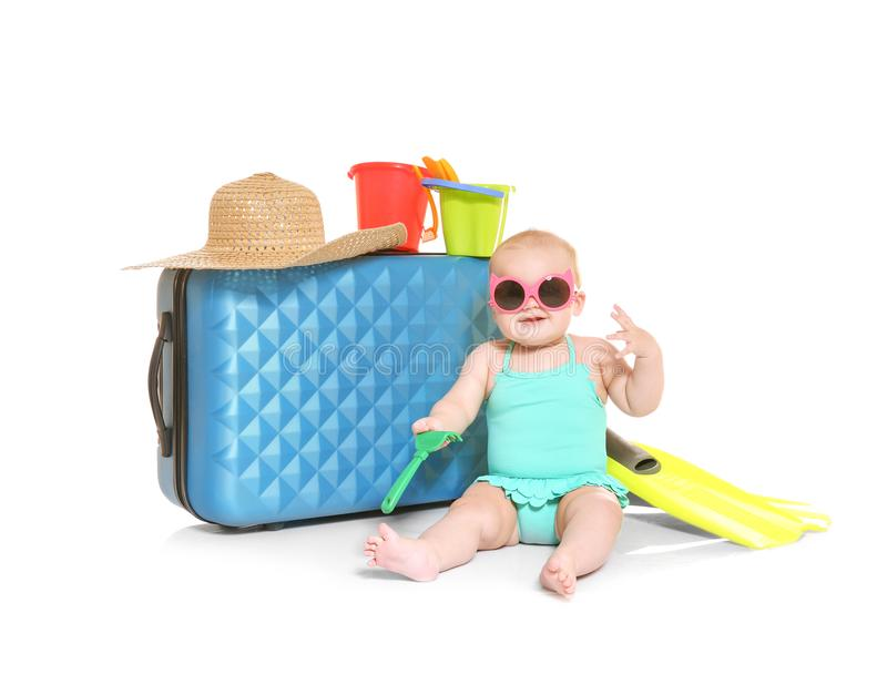 Baby girl in sunglasses with suitcase royalty free stock photo