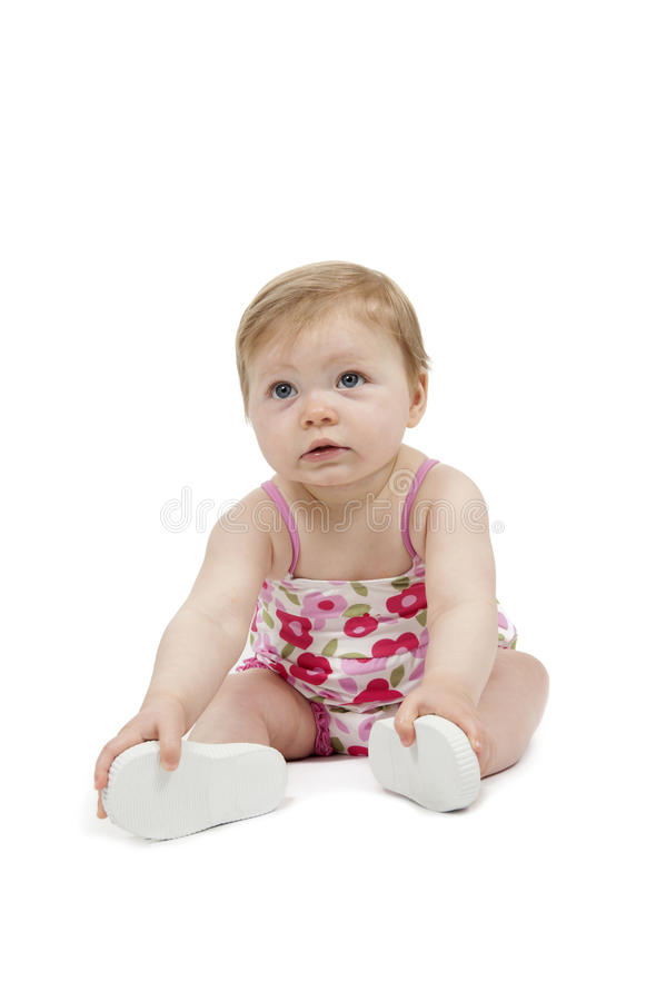 Baby girl in swimming suit. Isolated on white background royalty free stock photo