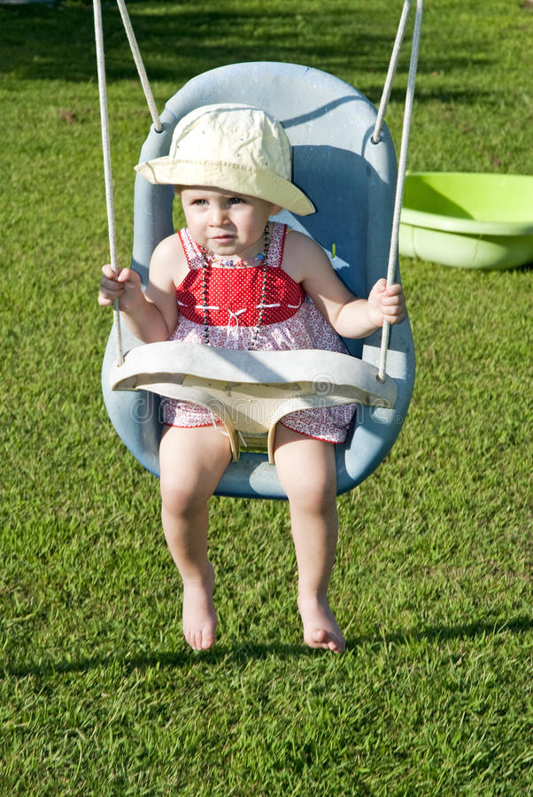 Download Baby girl on swing stock image. Image of white, yellow - 16065367