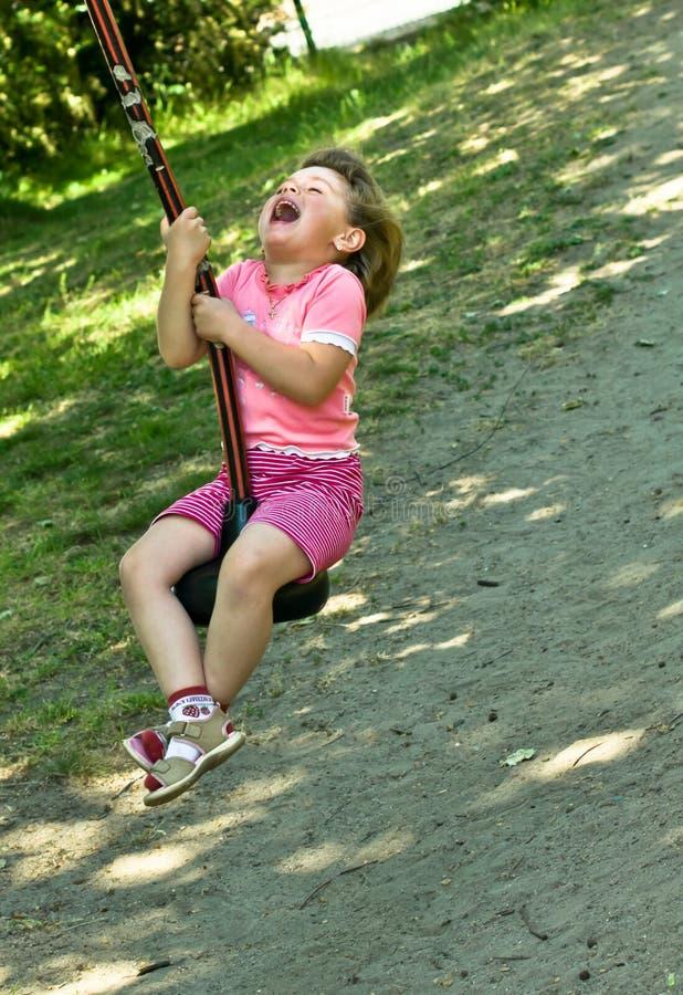 Baby Girl On The Swing Stock Image