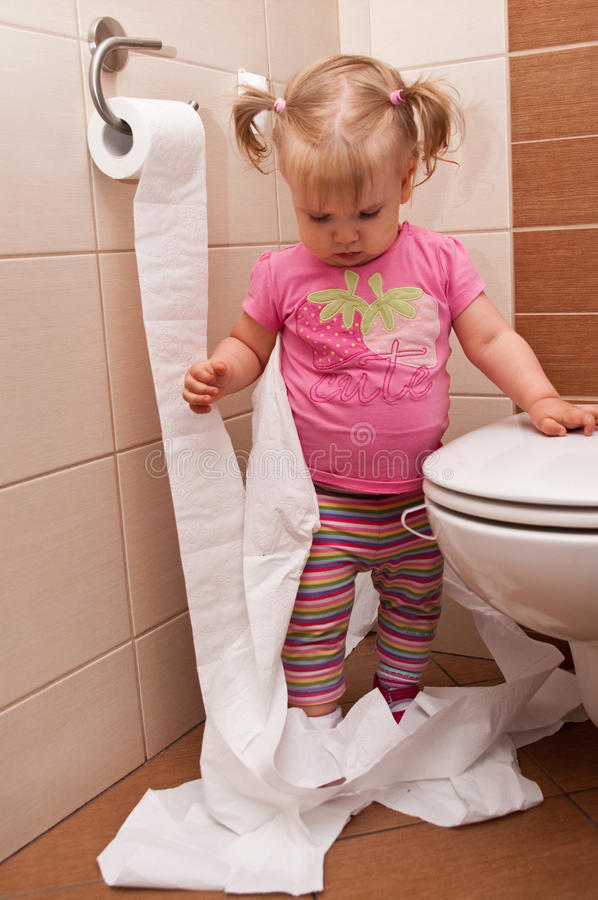 Baby girl with toilet paper stock images