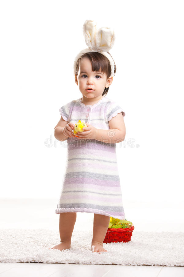 Download Baby girl with toy chicken stock photo. Image of costume - 12544154