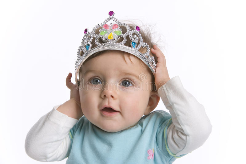 Baby girl with toy crown royalty free stock images