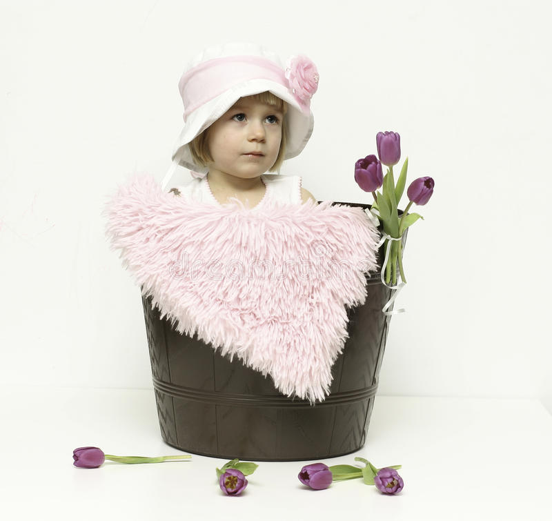 Baby girl and tulips royalty free stock photography