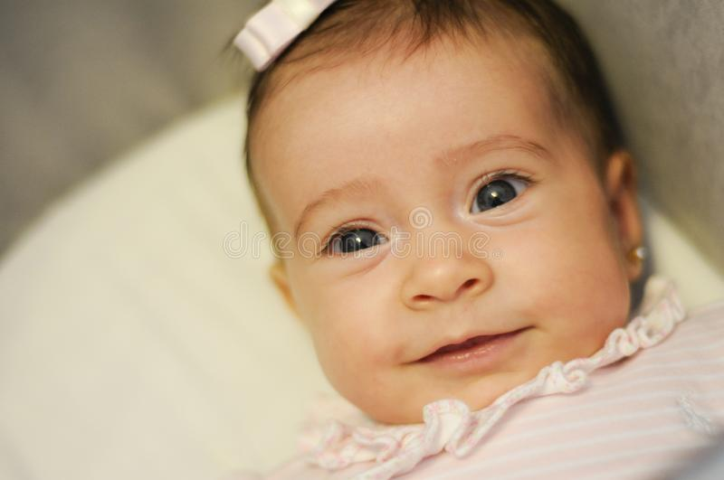 Baby girl two months old smiling stock photography