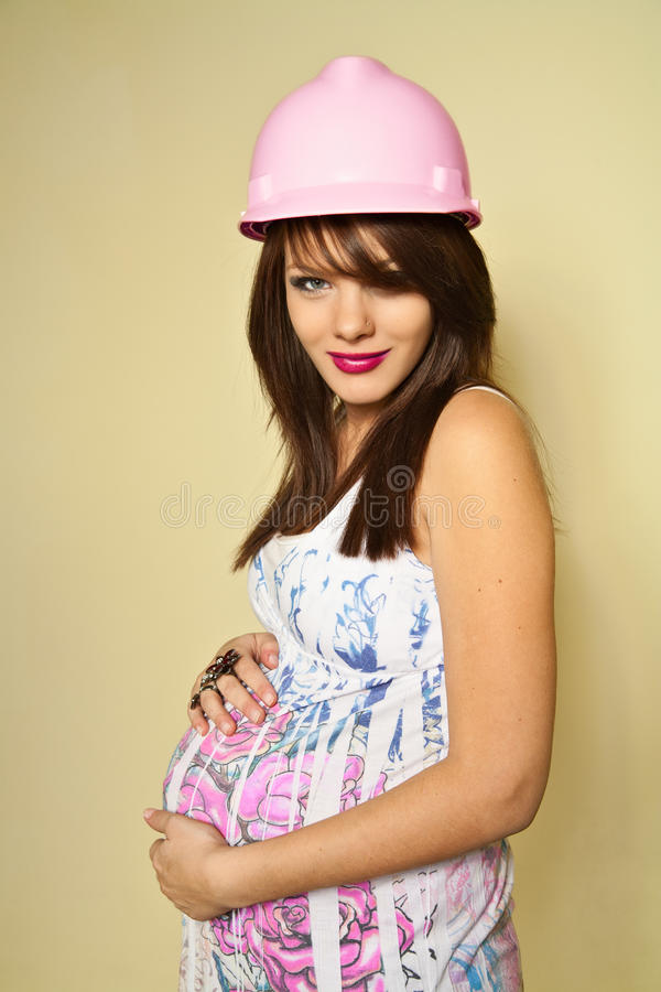 Baby Girl Under Construction (Pregnant) royalty free stock photography