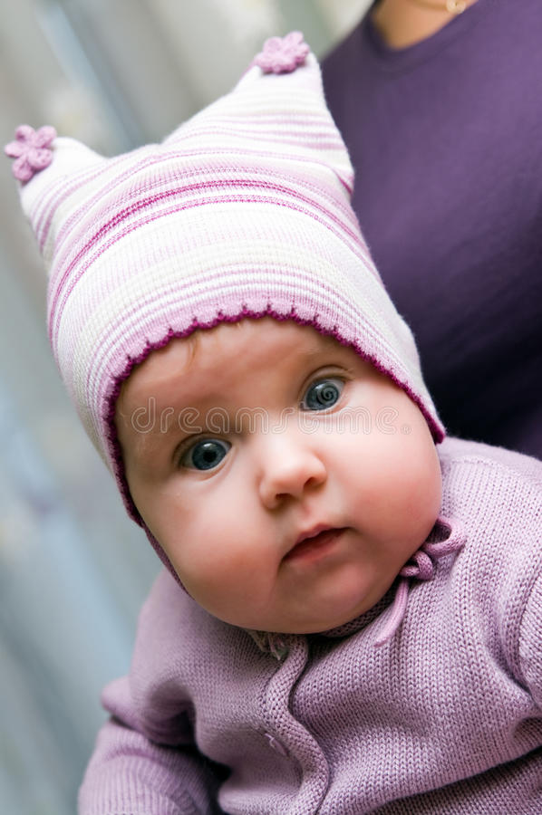 Baby girl in violet stock images
