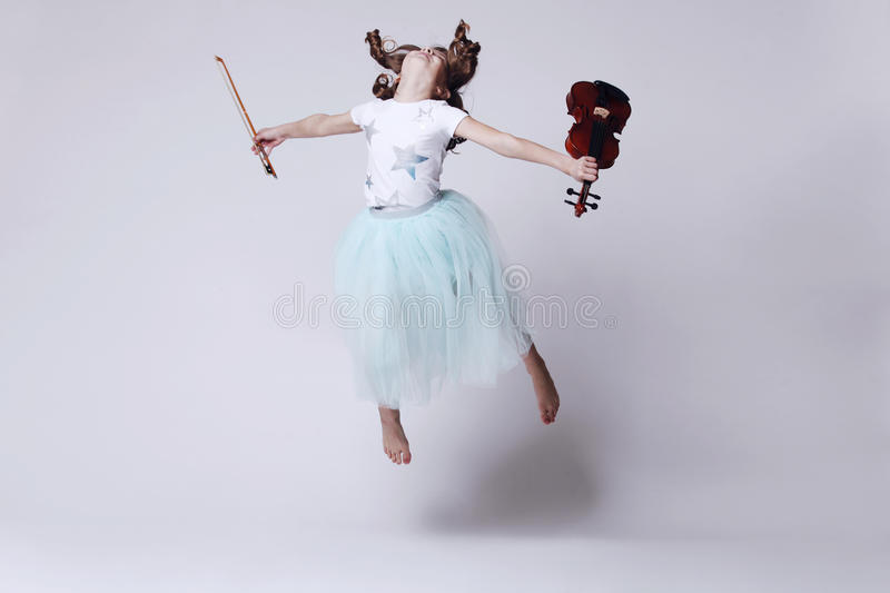 Baby girl with violin stock photo