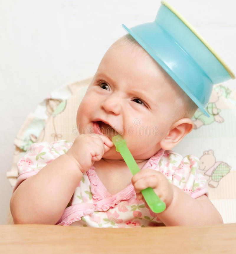 Download Baby Girl Waiting For Dinner Stock Photo - Image of meal, pretty: 26303744