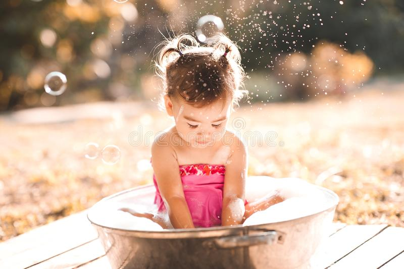 Baby girl outdoors royalty free stock images