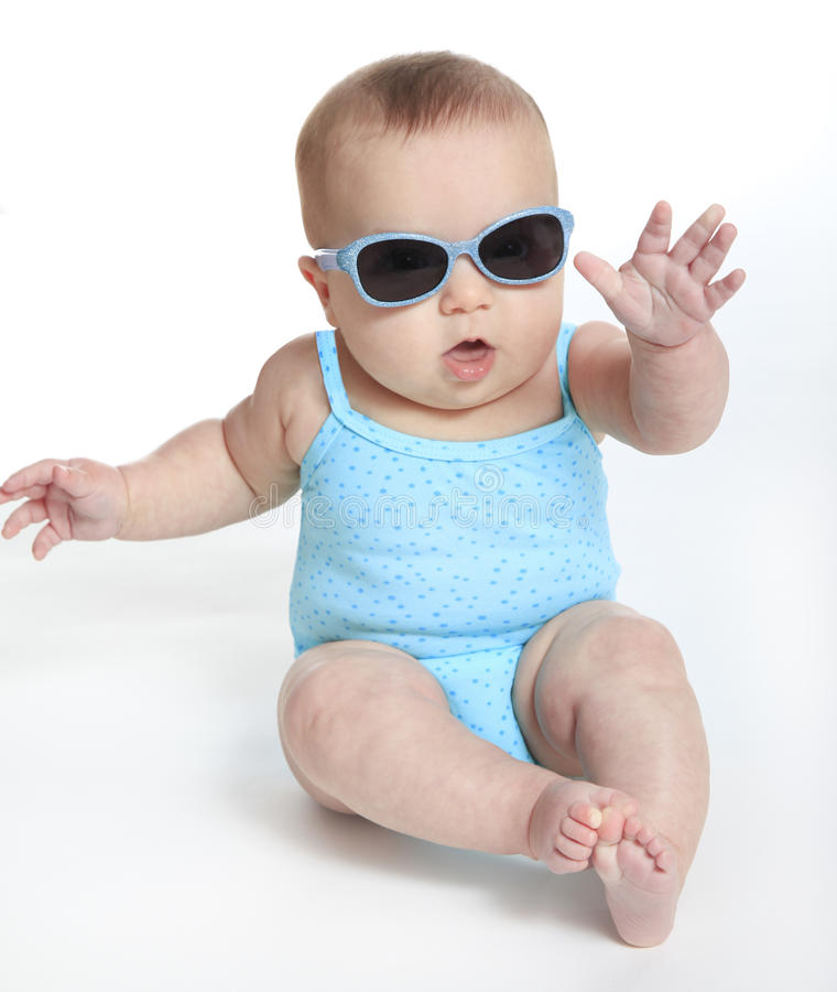 Free Baby Girl Wearing A Blue Swimsuit And Sunglasses Royalty Free Stock Photography - 62547237