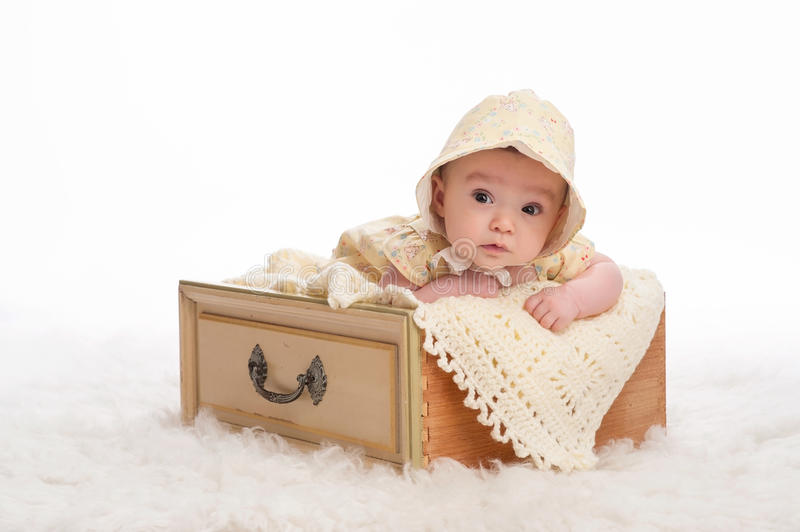 Baby Girl Wearing a Yellow Bonnet royalty free stock photos