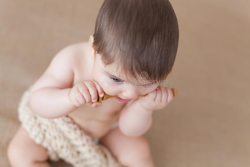 Baby girl with a wooden honey spoon - high angle royalty free stock photo