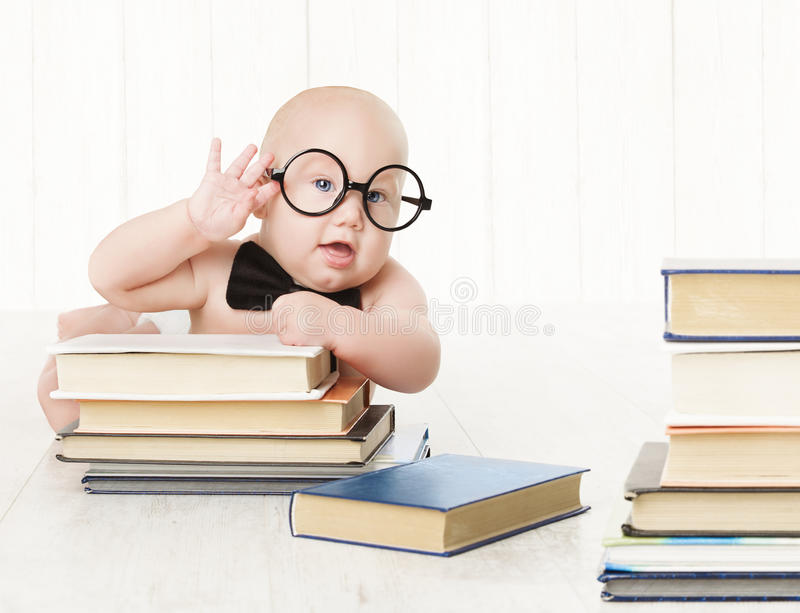 Baby in Glasses and Books, Kids Early Childhood Education stock photography