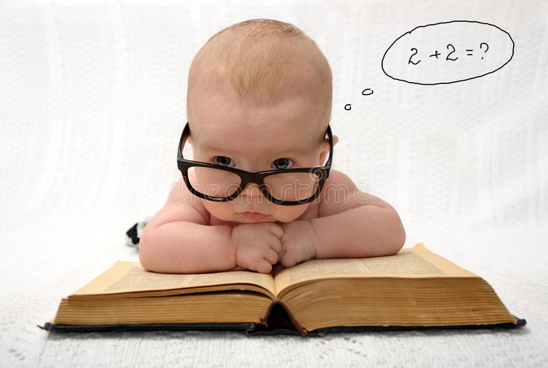 Baby in glasses counting in mind stock photos
