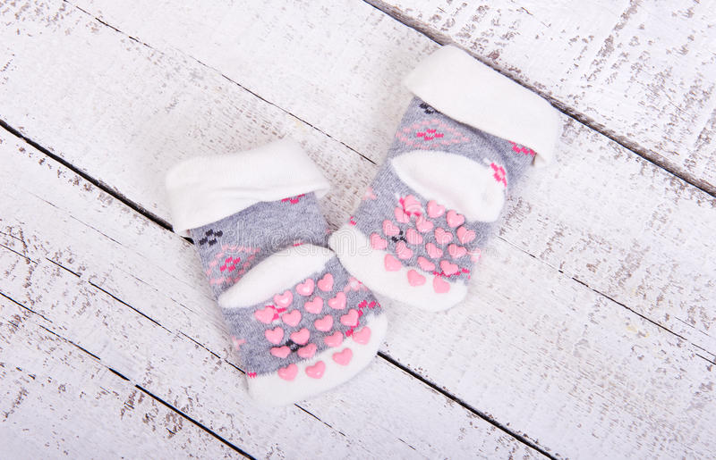 Baby goods. Children`s clothing children`s socks with pink hearts on a white stock photo
