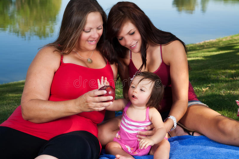 Baby Grabs the Apple stock photo