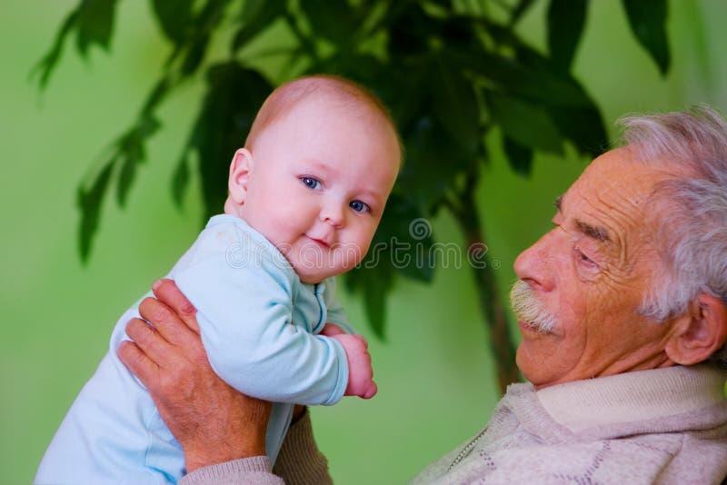 Baby With Grandpa Stock Photos