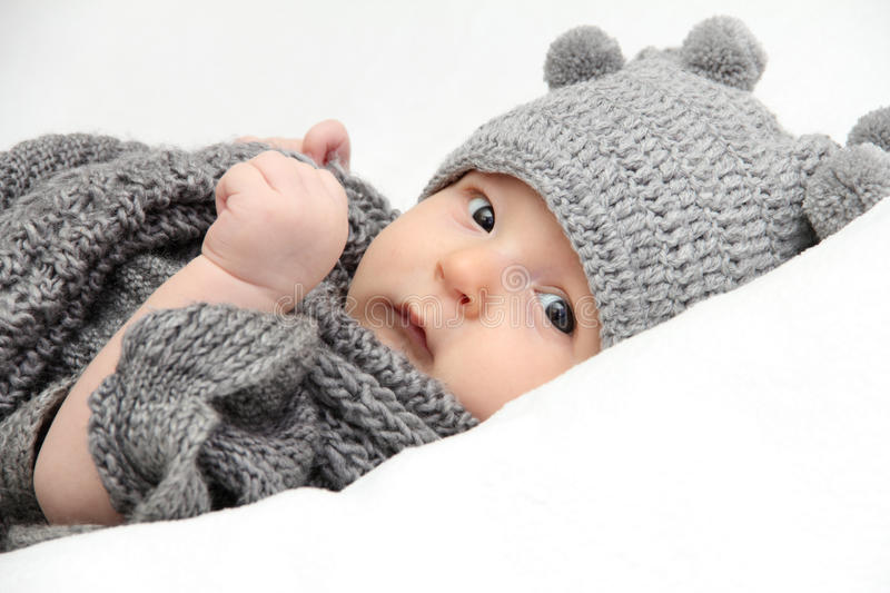 Baby in gray hat stock photography