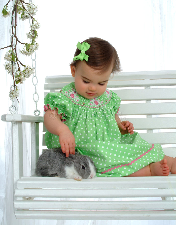 Download Baby in Green and Bunny stock image. Image of flower, clothing - 4864377
